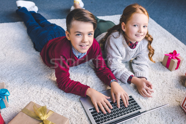 brother and sister using laptop together Stock photo © LightFieldStudios