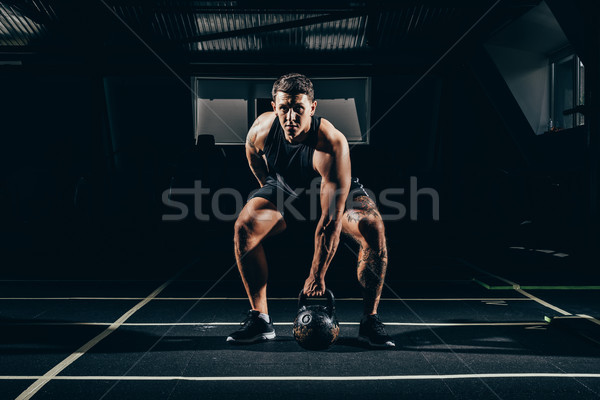 sportsman lifting  up kettlebell Stock photo © LightFieldStudios