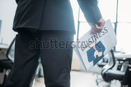 businessman with suitcase calling elevator Stock photo © LightFieldStudios