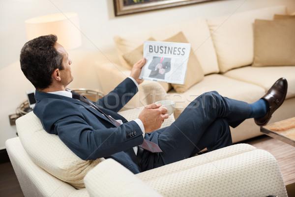 businessman reading newspaper with coffee Stock photo © LightFieldStudios