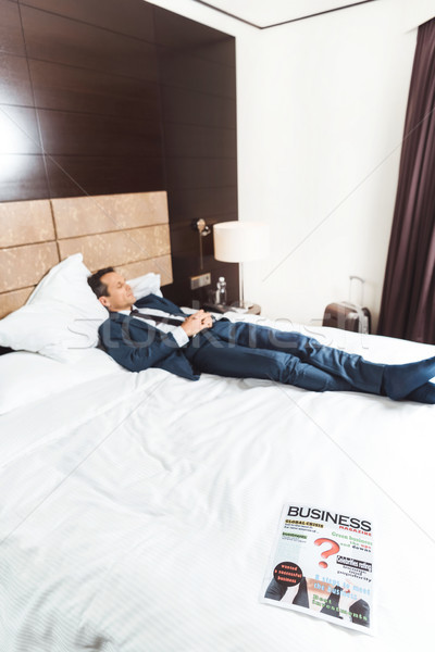 Business newspaper on hotel bed Stock photo © LightFieldStudios