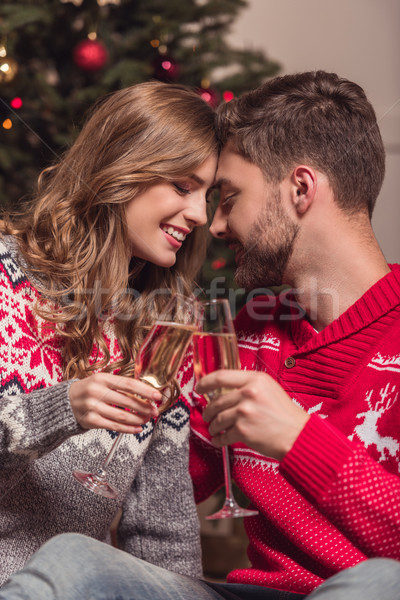 couple drinking champagne at christmas Stock photo © LightFieldStudios