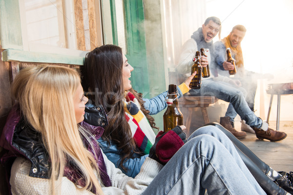 Oldalnézet derűs barátok iszik sör veranda Stock fotó © LightFieldStudios