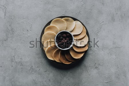 top view of fresh pancakes with blackberries on grey  Stock photo © LightFieldStudios