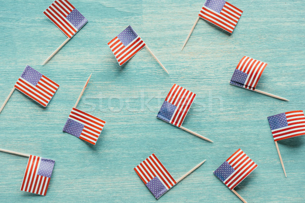 top view of arranged american flags on blue wooden surface, presidents concept Stock photo © LightFieldStudios