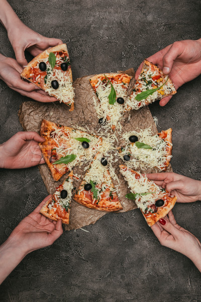 Vue personnes tranches pizza Photo stock © LightFieldStudios
