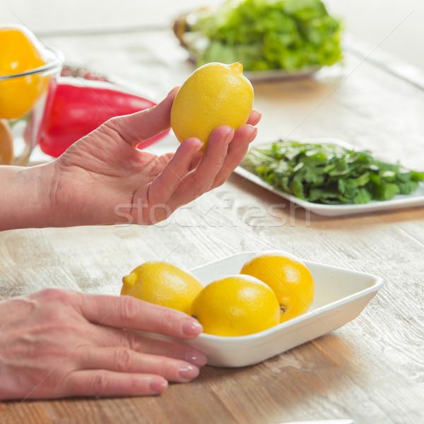 Female hands inspecting lemons Stock photo © LightFieldStudios