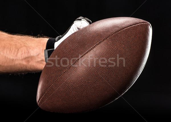 Futballista tart labda közelkép kilátás kéz Stock fotó © LightFieldStudios