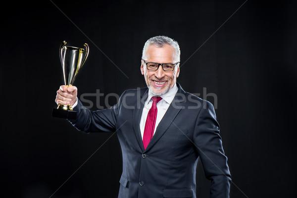 Businessman with award cup Stock photo © LightFieldStudios