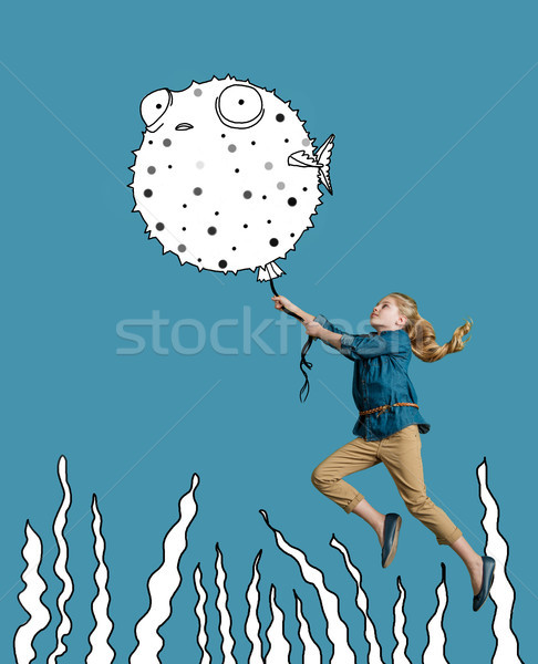 girl underwater, holding porcupinefish Stock photo © LightFieldStudios