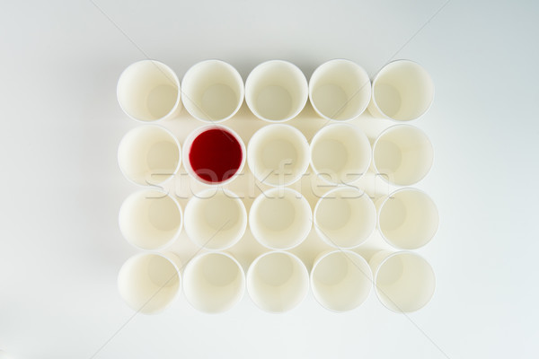 Top view of set of empty plastic cups and one with red paint Stock photo © LightFieldStudios