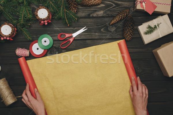 woman decorating christmas gifts Stock photo © LightFieldStudios
