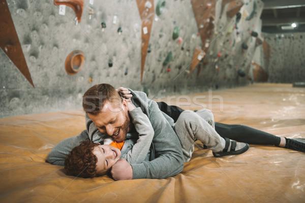 dad knocking down son on mat Stock photo © LightFieldStudios