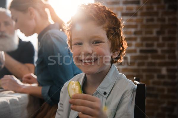 Piccolo ragazzo pezzo cetriolo messa a fuoco selettiva sorridere Foto d'archivio © LightFieldStudios