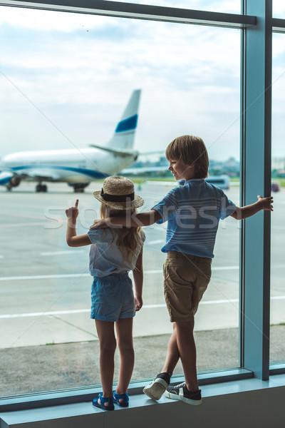 kids looking out window in airport Stock photo © LightFieldStudios