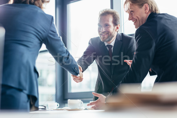 businessmen shaking hands Stock photo © LightFieldStudios