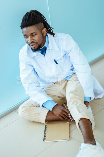 doctor sitting on hospital floor Stock photo © LightFieldStudios
