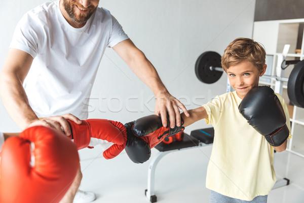 тренер мальчики боксерские перчатки выстрел , держась за руки рук Сток-фото © LightFieldStudios