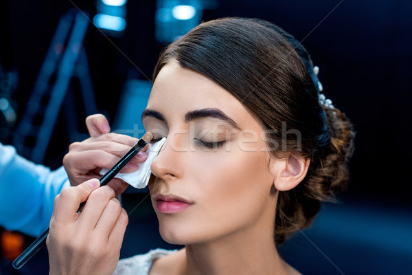 makeup artist applying eye shadows Stock photo © LightFieldStudios