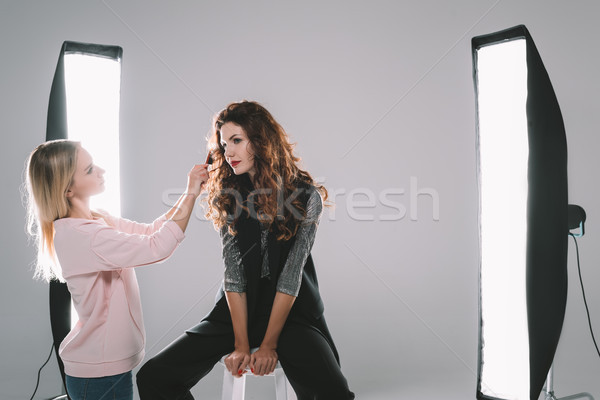 attractive model and hair stylist  Stock photo © LightFieldStudios