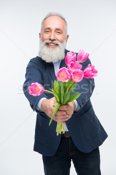 Senior man with tulips  Stock photo © LightFieldStudios