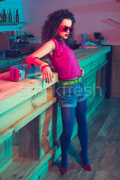 fashionable woman leaning on counter Stock photo © LightFieldStudios