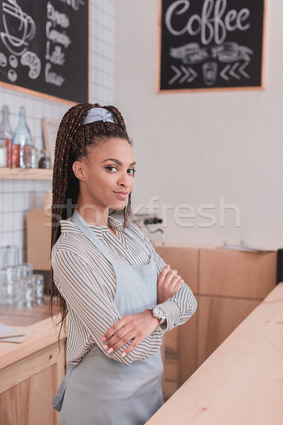 barista standing with arms crossed Stock photo © LightFieldStudios