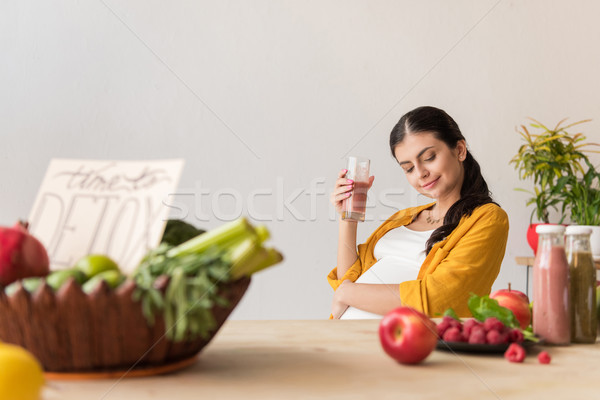 pregnant woman with detox drink in hand Stock photo © LightFieldStudios