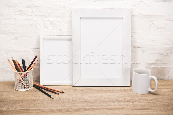 photo frames and coffee cup on tabletop Stock photo © LightFieldStudios