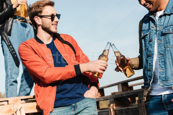 Multicultural amigos bebidas vista hombres alcohol Foto stock © LightFieldStudios
