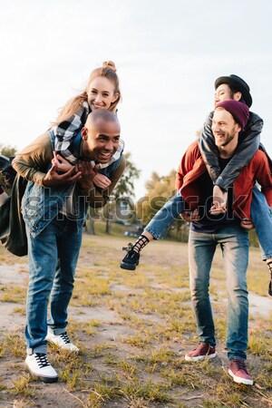 multicultural friends in park Stock photo © LightFieldStudios
