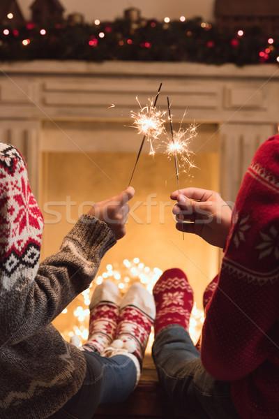 Pareja sesión chimenea año nuevo Foto stock © LightFieldStudios