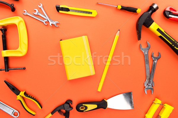 yellow notebook and reparement tools Stock photo © LightFieldStudios