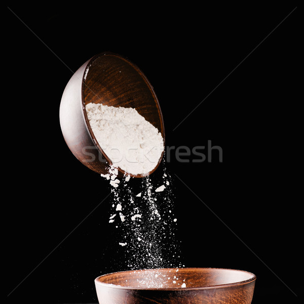 bowl with falling flour into another bowl isolated on black Stock photo © LightFieldStudios