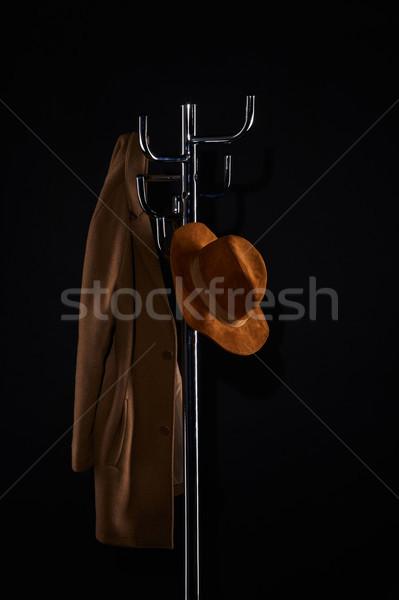Kalap kabát akasztás fogas izolált fekete Stock fotó © LightFieldStudios