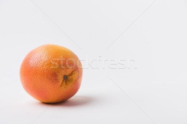 raw unpeeled orange laying on white background  Stock photo © LightFieldStudios