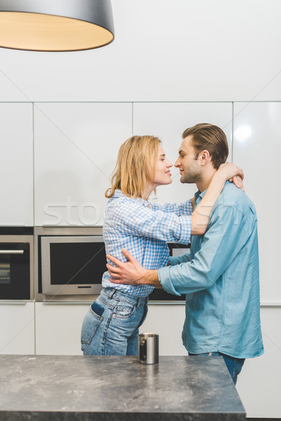 side view of affectionate couple hugging each other at home Stock photo © LightFieldStudios
