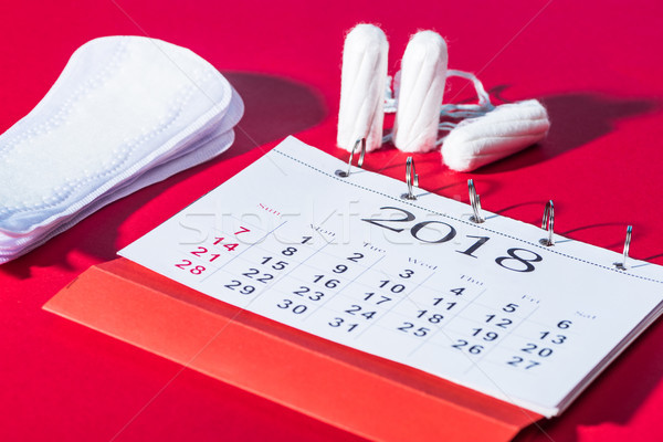 tampons, daily pads and calendar on red Stock photo © LightFieldStudios