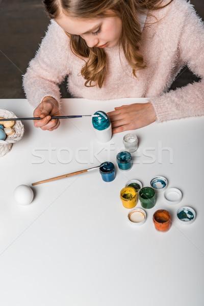 cropped shot of cute little girl painting egg for Easter  Stock photo © LightFieldStudios