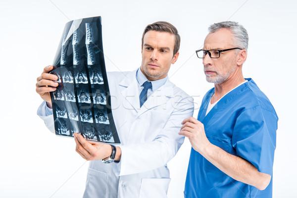 Doctors examining x-ray image Stock photo © LightFieldStudios