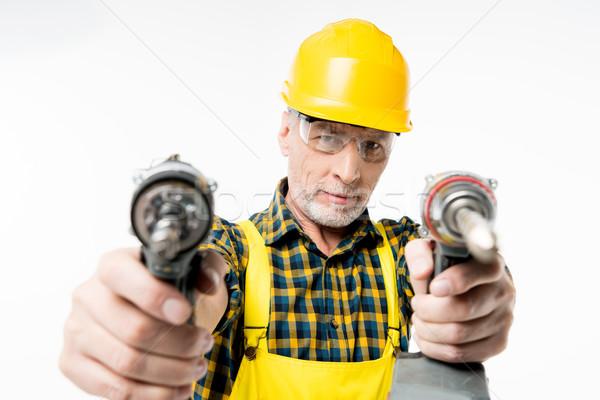 Workman holding electric drills Stock photo © LightFieldStudios