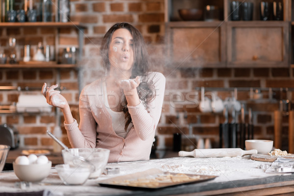 'Young woman having fun with flour while making dough on kitchen Stock photo © LightFieldStudios