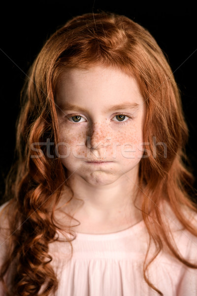 portrait of adorable offended redhead girl looking at camera isolated on black Stock photo © LightFieldStudios