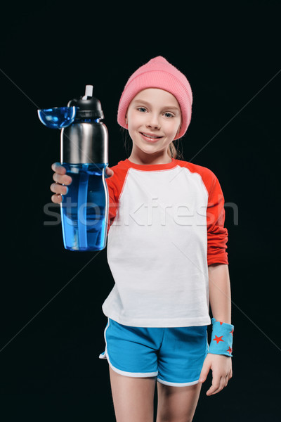 girl in sportswear holding sport bottle isolated on black. athletics children concept Stock photo © LightFieldStudios