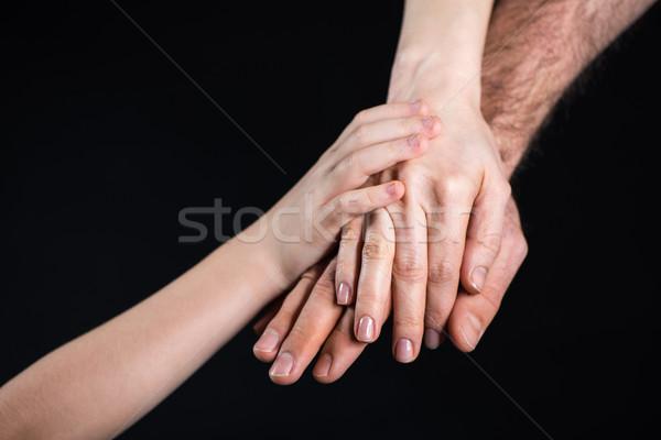 Family stacking hands Stock photo © LightFieldStudios