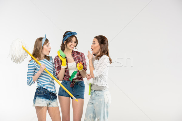 Young women with cleaning supplies Stock photo © LightFieldStudios