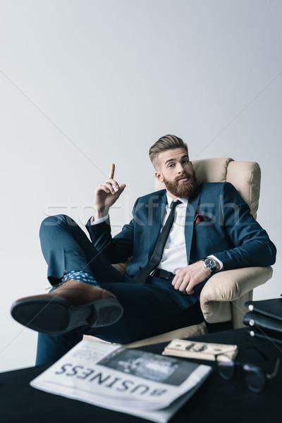 Elegancki biznesmen posiedzenia fotel biuro działalności Zdjęcia stock © LightFieldStudios