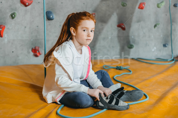 Little girl sitting on mat in gym Stock photo © LightFieldStudios