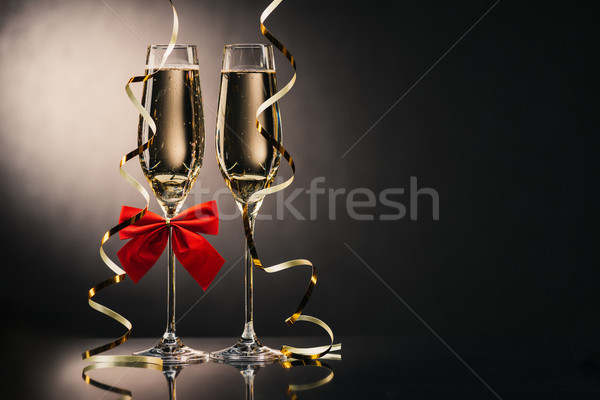 glasses of champagne with ribbons Stock photo © LightFieldStudios