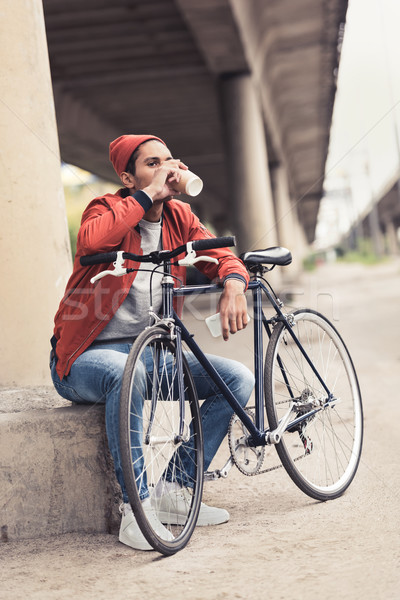 man with bicycle drinking coffee to go Stock photo © LightFieldStudios
